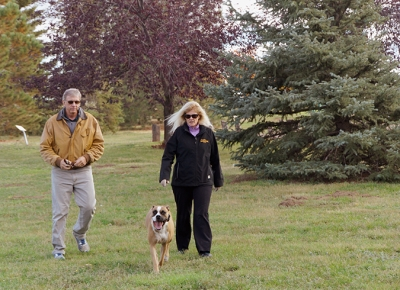 Diane and Bill Monahan walking their dog at CAM-PLEX Park in Gillette, Wyoming